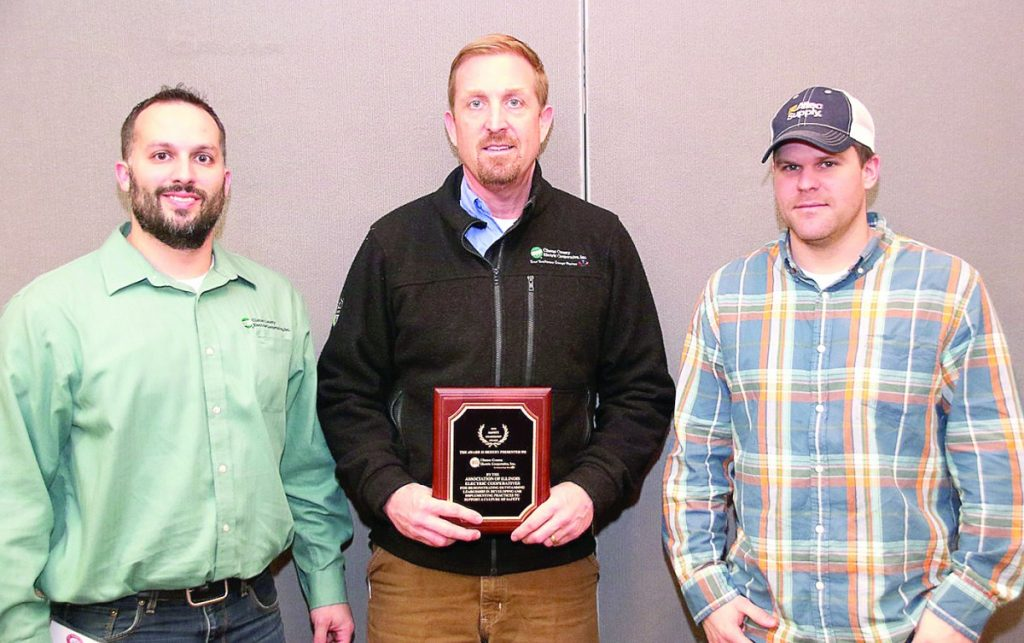 Accepting the safety award for Clinton County Electric Cooperative, Inc., are, from left: Technical Services Supervisor Ahren Langhauser, Operations Superintendent Brian Taylor and Apprentice Lineman Justin Hubert.