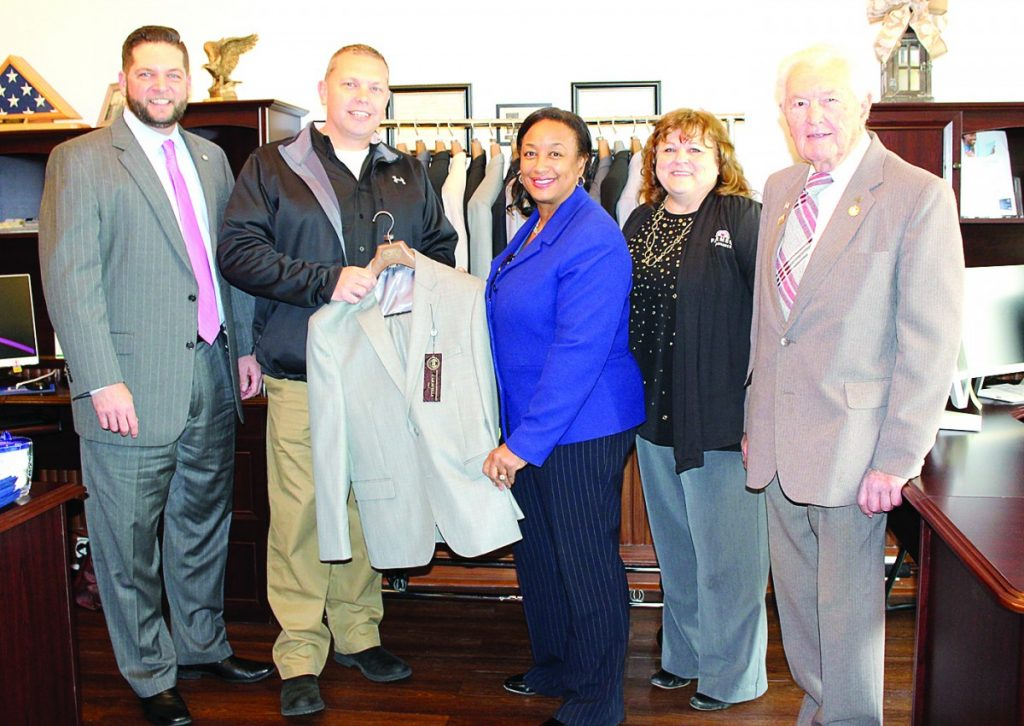 Pictured are Jeff Flowerree, Farmer's Insurance District Manager; Steve Davis, CEO and President of Jim's Formal Wear; Marcena Gunter, Veterans Public Affairs Manager; Cheryl Parkin, Farmer's Insurance and Financial Agent; and Howard Harpstrite of the Harpstrite Insurance Agency.  HERALD