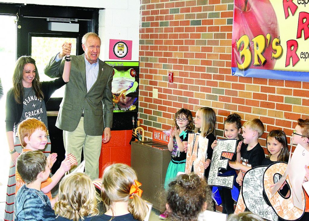 Kindergarten teacher Katie Mense and her students welcome Governor Bruce Rauner to New Baden Elementary on Monday, April 24.  HERALD
