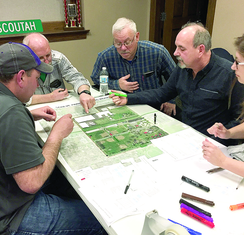 Mark Beer, Jack Weyant, Steve Heizer, and Pat McMahan study future plans for Scheve Park.  Submitted photo