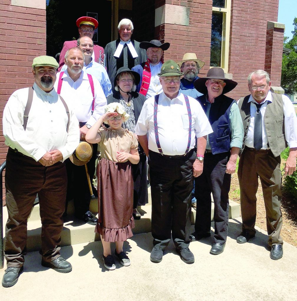 Participants of the Mascoutah Cemetery Walk included: (front row) Joe Zinck, Abbie Lands, Jerry Daugherty, Rob Welch, Greg Hoskins; (middle row) Larry Wesselman, Paulina Teichmann, Douglas Clark; (third row) Bill Millikin, Aaron Lands; (back row) Andrew Renth, and Pastor Hugh Fritz.  Photo by Linda Hoskins