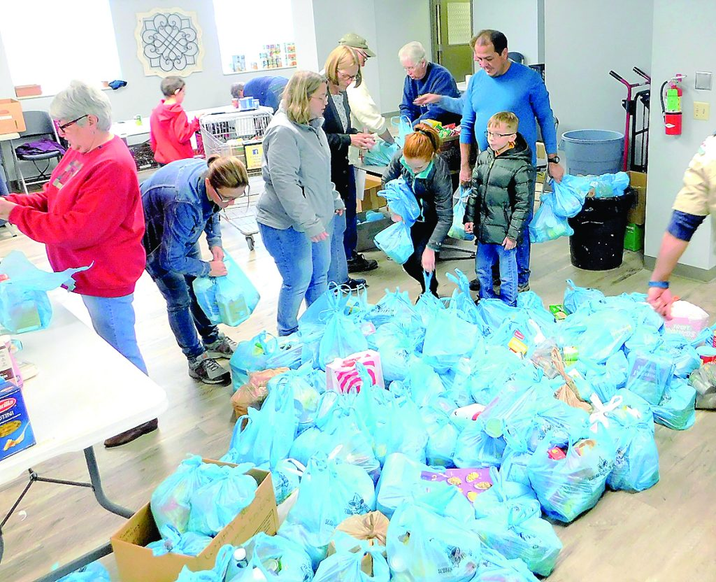 So many bags of donations were picked up from local homes that there, for a brief time, was a shortage of space for where to set them inside the Fairview Heights Food Pantry.