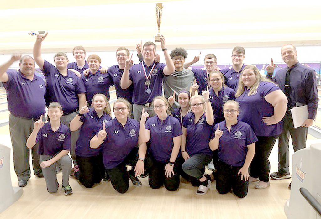 The MHS Bowling teams celebrate at the conclusion of the Belleville East Tournament.