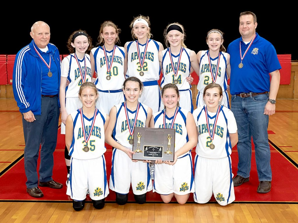 On January 6, the Holy Childhood Apaches girls 8th grade basketball team defeated the St. Clare Knights 34-14 in the Diocesan Championship game.  Pictured above are (front row, L-R) Josie Athy, Katie Schneider, Jackie Amann, Izzy Hoerchler; (Back row, L-R) Head coach Rich Thompson, Bella Hart, Sofia Loden, Sarah Whittom, Annie Beck, Emma Uptergrove, and Asst. Coach Adam Uptergrove.  Photo by Jim Recuero