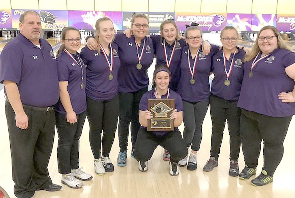 The MHS Girls Bowling team celebrates after winning the Panther Challenge, Saturday, January 5.  Picture from left to right Coach Gary Gruberman, Hannah Krener, Katie Richter, Olivia Wilhelm, Emma Herman, Emily Stevens, Breanne West and Juliet Johnson. Kneeling is Corynne Bean holding the first place plaque.  Submitted photo