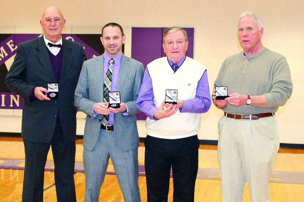 Pictured are: (L-R) Floyd Lorenz, Nick Carr, Roger Bergheger, and former Track and Field Head Coach at Mascoutah High School Jerry Jones representing Hall of Fame inductee Chris Martin who was unable to attend the ceremony.