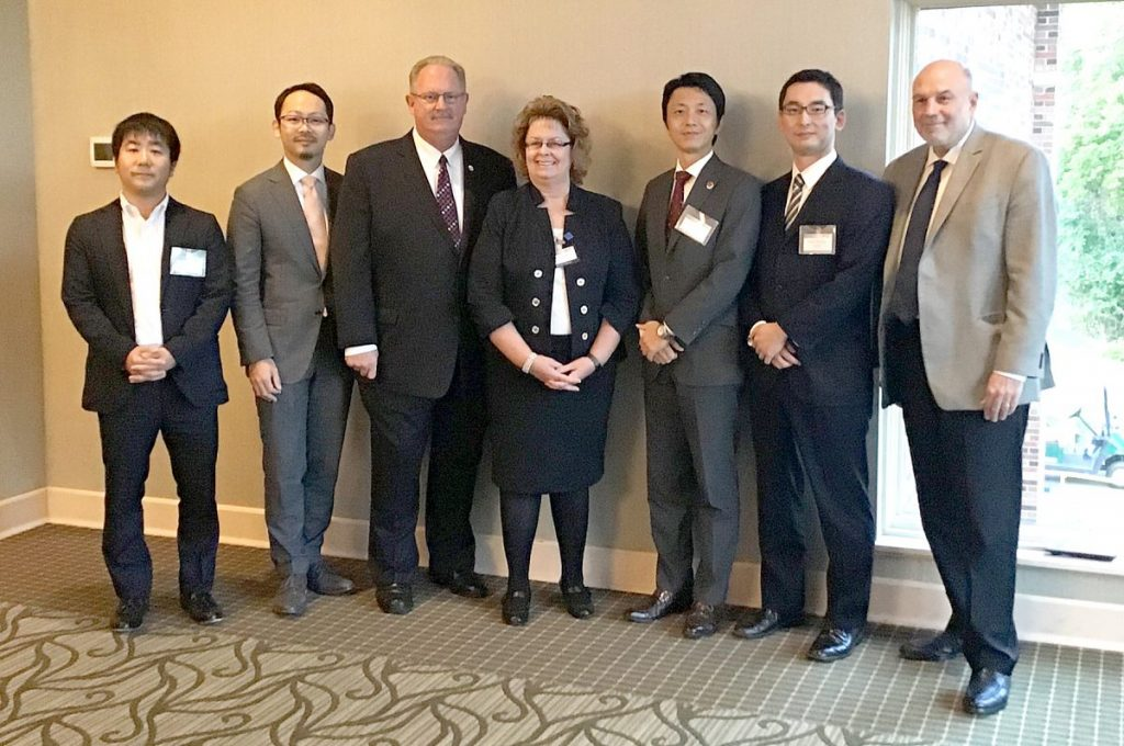 Belleville Mayor Mark Eckert is pictured with Dr. Ronda Sauget, executive director and CEO of the Leadership Council of Southwestern Illinois; Ralph Inforzato, chief executive director of the Japan External Trade Organization; and several Japanese business leaders Friday in Belleville at the Japan Forum hosted by the Leadership Council of Southwestern Illinois.