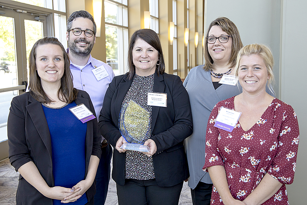Representatives from HSHS St. Joseph's Hospital Breese who attended the IHA Leadership Summit to accept the award were (left to right) Allison Satterthwaite, manager of infection prevention; Zach Yoder, chief nursing officer; Danielle Trame, manager of surgical services; Lisa Jones, facilitator for central sterile and Melissa Cates, director of quality.