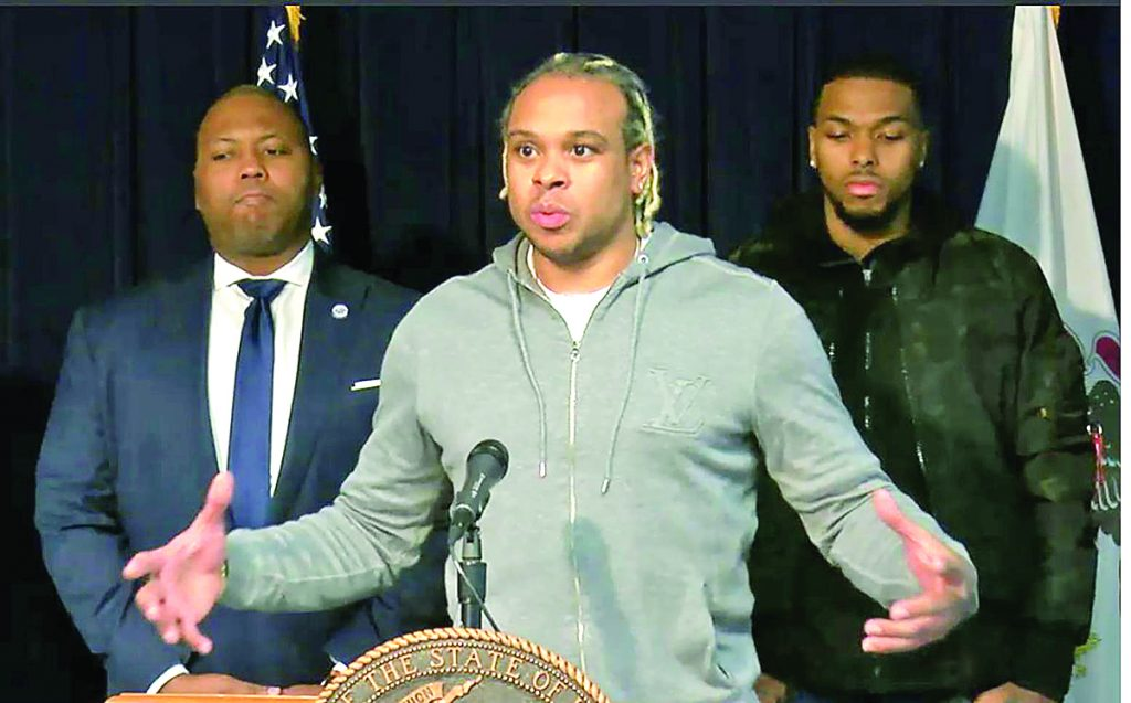 Shannon Brown, a former NBA player who won two championships with the Los Angeles Lakers and grew up in the Chicago suburbs, gives his support to an Illinois bill that would allow college athletes to collect endorsement deals at a Chicago news conference Friday. Brown is joined by his younger brother Sterling Brown, at right, who currently plays for the NBA's Milwaukee Bucks, and state Rep. Kambium Buckner, D-Chicago, who is a cosponsor of the bill. Photo by blueroomstream.com
