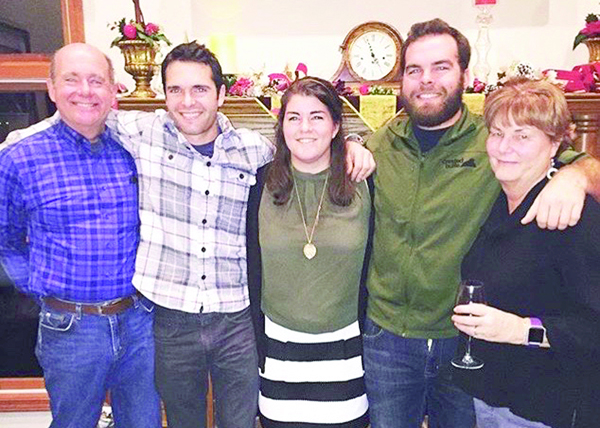 The Munie family celebrates at a recent gathering. Joe Munie, left, and his wife Linda, right, flank their children, from second left, Clare, Craig and Matt Munie. Courtesy photo