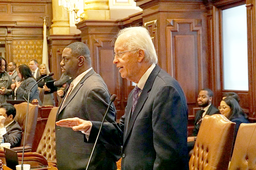(File Photo) State Sen. Terry Link, D-Indian Creek, (right) speaks on the Senate floor during last year's legislative session. Facing federal charges, he resigned his Senate seat effective Saturday, Sept. 12. (Credit: Lee Milner, Illinois Times)