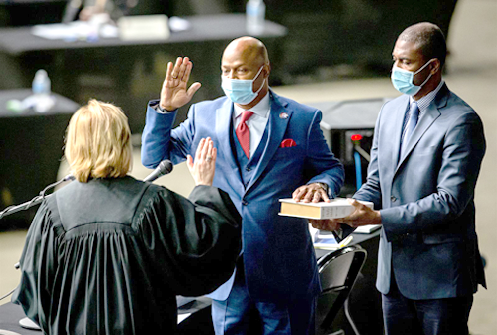 """Rep. Emanuel """"Chris"""" Welch, D-Hillside, takes the Oath of Office to become the House speaker for the 102nd General Assembly for the Illinois House of Representatives on Wednesday at the Bank of Springfield Center. (Credit: Justin L. Fowler of The State Journal-Register)"""