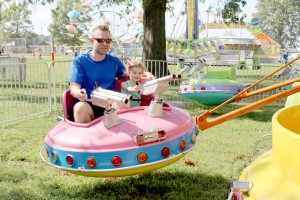 man and little boy on ride 8787